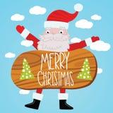 Święty Mikołaj z drewno stołem. Bożenarodzeniowy tło Zdjęcia Royalty Free