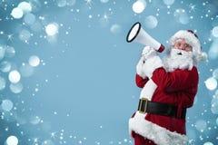 Święty Mikołaj z megafonem Zdjęcia Royalty Free