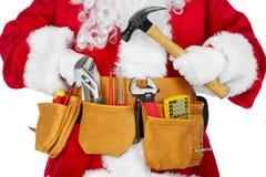 Święty Mikołaj z narzędziowym paskiem Fotografia Stock