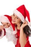 Święty Mikołaj z seksowną dziewczyną Zdjęcie Royalty Free