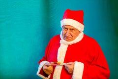 Święty Mikołaj z taśmy miarą obraz stock