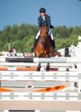 ŚWIĘTY PETERSBURG-JULY 05: Jeździec Aleksandr Belekhov na kojocie Ugl Obraz Royalty Free