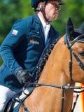 ŚWIĘTY PETERSBURG-JULY 06: Jeździec Alexandr Belehov w CSI3*-W/ Zdjęcia Royalty Free