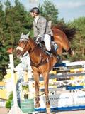 ŚWIĘTY PETERSBURG-JULY 05: Jeździec maksyma Kryna na Klooney 26 w CSI Zdjęcia Stock