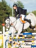 ŚWIĘTY PETERSBURG-JULY 05: Jeździec Mikhail Safronov na Copperphild Obrazy Stock
