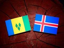 Święty Vincent i grenadyny zaznaczamy z Islandzką flaga na t obraz stock