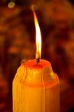 Światło świeczka w zmroku Obrazy Royalty Free