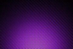 Światło reflektorów na purpurowym węgla włóknie Zdjęcie Royalty Free