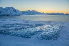 Światło słoneczne nad arktycznym fjord Obraz Stock