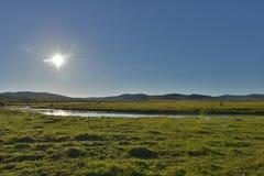 Światło słoneczne nad Hulun Buir obszarem trawiastym Zdjęcie Royalty Free