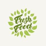 Świeża żywność logo, odznaka, etykietka Ręka pisać literowanie Zdjęcie Stock