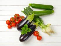 Świeża oberżyn, pomidorów, zucchini i wiosny cebula, Obraz Stock