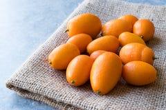 Świeżej owoc Kumquat, Cumquat na worku/ Obrazy Stock