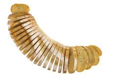 Świeży bochenek pokrojony rozmarynów i gruli chleb Obrazy Stock