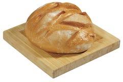 Świeży chleb na drewnianej desce odizolowywającej na bielu Fotografia Stock