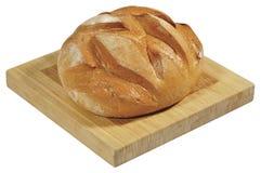 Świeży chleb na drewnianej desce odizolowywającej na bielu Obrazy Stock