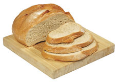 Świeży chleb na drewnianej desce odizolowywającej na bielu Obraz Royalty Free