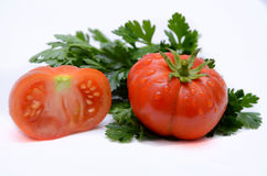 Świeży pomidor z liść pietruszką Zdjęcie Royalty Free