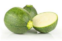 Świeży surowy round zucchini odizolowywający na bielu obrazy royalty free