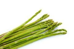 Świeży zielony szparagowy warzywo na białym tle Obrazy Stock