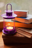 Świeczka i książki Obrazy Stock