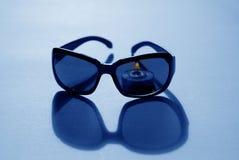 świeczka okulary przeciwsłoneczne zdjęcia royalty free