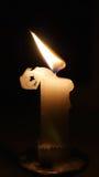 Świeczka płomień, ciemność, wosku fryzowanie Fotografia Stock