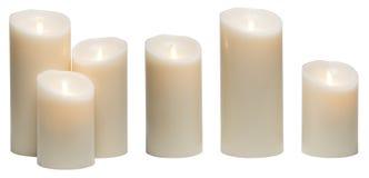 Świeczki światło, Białe świeczki wosków świateł Odizolowywających na bielu fotografia stock
