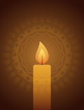 Świeczki światło na dekoracyjnym tle Fotografia Stock