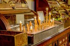 Świeczki i pisać modlitwa zdjęcia royalty free