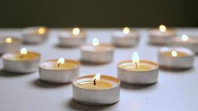 Świeczki okamgnienia tła Migocący światło od świeczek Świeczki tło zbiory