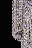 Świecznika światło w wnętrzu, Chrystal świecznika zakończenie krystaliczna część od świecznika, świecznik, oświetlenie, wyposażen Fotografia Royalty Free