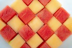 Świezi arbuzy i melony na białym tle obraz stock