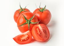 Świezi czerwoni pomidory na białym odosobnionym tle zdjęcia stock