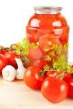 Świezi i konserwować pomidory Fotografia Royalty Free