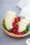 Świezi melonów plasterki z malinką i miodem Obraz Stock