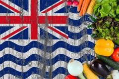 ?wiezi warzywa od Brytyjskiego oceanu indyjskiego terytorium na stole Kulinarny poj?cie na drewnianym chor?gwianym tle obrazy royalty free