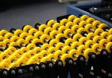 Żółci Plastikowi rolowniki dla transportu fotografia stock