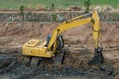 Żółta ekskawator maszyny ciężkie obraz royalty free
