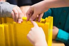 Żółta plastikowa konstruktor tekstura Obrazy Stock