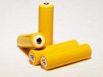 Żółte do naładowania baterie Zdjęcia Royalty Free