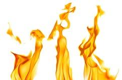 Żółte iskry trzy jaskrawego płomienia na bielu zdjęcia stock