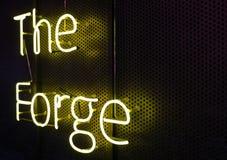 Żółtego światła neonowy writing na czarnym tle Obraz Stock