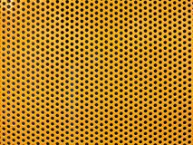 Żółtego metalu dziura lub dziurkowaty siatki tło obrazy stock