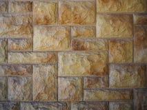 Żółty kamiennej ściany abstrakta tło zdjęcia stock