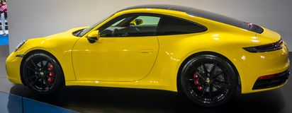 Yellow Porsche 911 Carrera 4S 2019 on 54th Belgrade international car and motor show