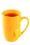 Żółty wysoki kubek herbata z etykietką zdjęcia royalty free
