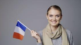 Żeńska mienie flaga Francja