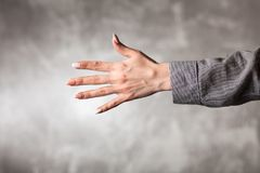 Żeńska ręka na ciemnym tle Zdjęcia Royalty Free