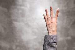 Żeńska ręka na ciemnym tle Fotografia Stock